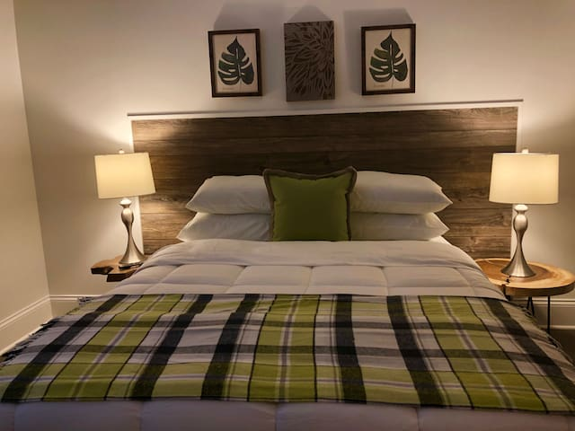 Custom headboards are quirky and fun. Unique art work and furniture makes each space individual.