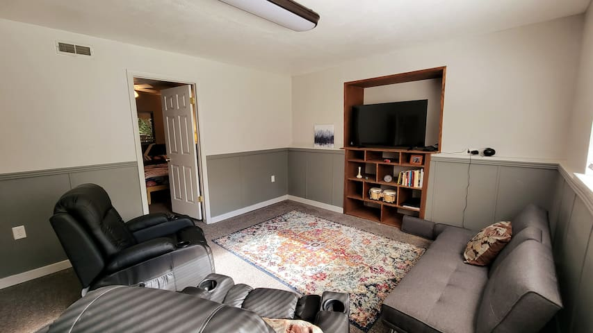 """Private living area w/ 50"""" smart tv and heated recliners"""