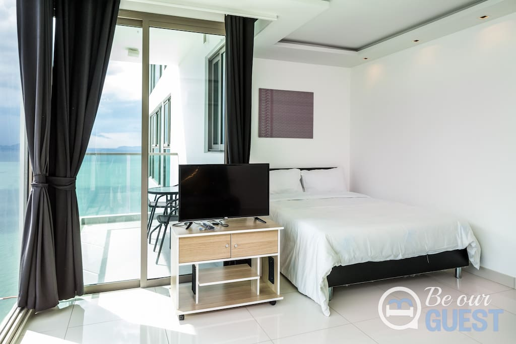 Queen size bed with LED TV