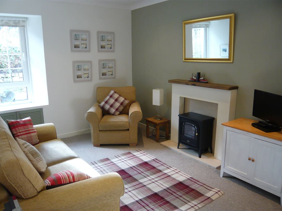 "Living room with electric ""wood burning stove"", TV with Freeview"
