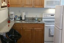 Updated full ,eat in, kitchen! Granite counter tops, full size oven, stove, microwave, refrigerator