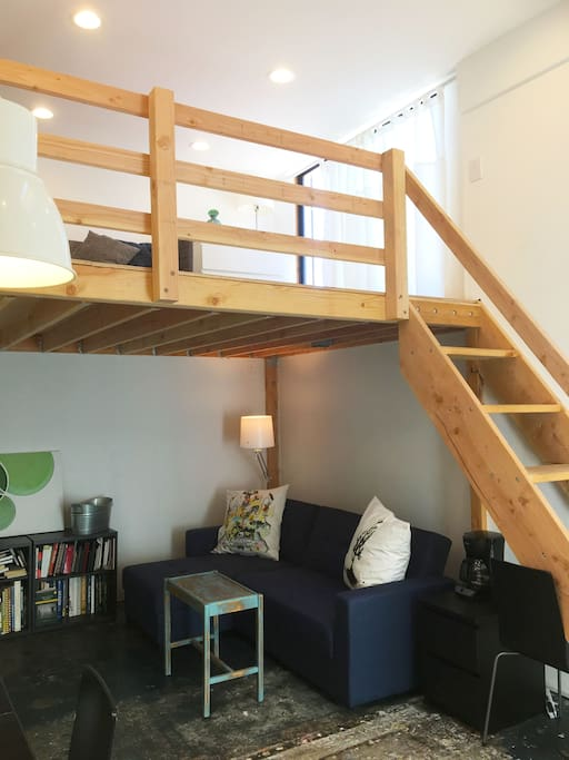 Loft space has quaint lounge area