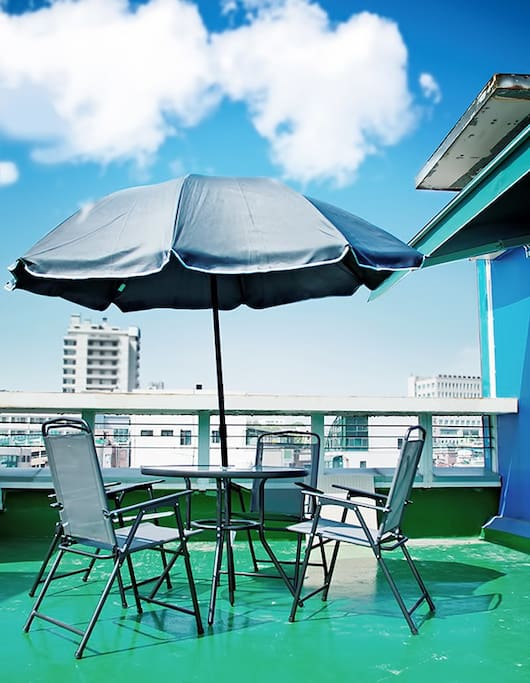 There is a seating area on the rooftop.