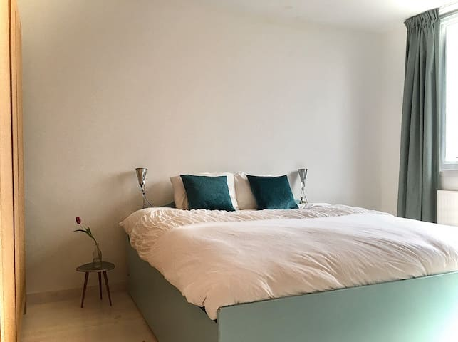 The main bedroom features a kingsize bed. We've recently invested in a high-quality mattress and you'll surely sleep like royalty. The bathroom is next to this room. There's storage space for your clothes available.