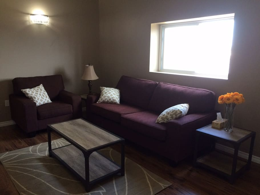The living room features a comfortable couch and chair, gorgeous end tables and an area rug.  Also included is a 40 inch smart tv and full access to Netflix, allowing you to enjoy commercial free viewing of a wide variety of movies and series.