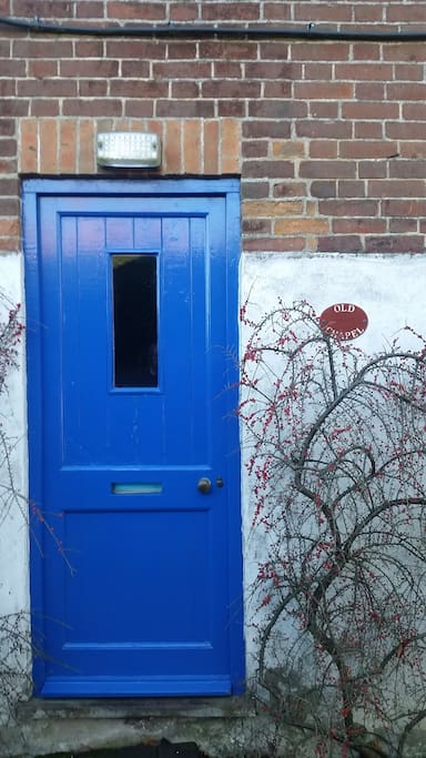 The blue front door with Old Chapel sign