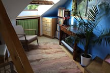 This area of the Suite has a desk, a small fridge, a place to make coffee or tea and a keyboard and kids books. And a view out the skylight.