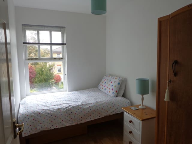Light and airy single room with own bathroom.
