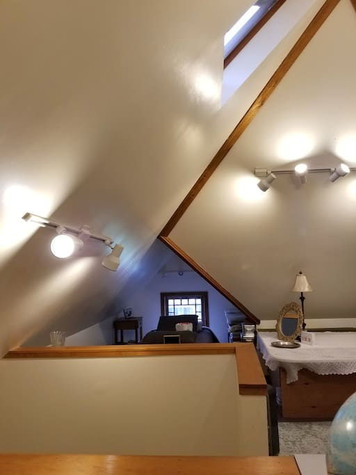 There is a skylight with high vaulted ceilings
