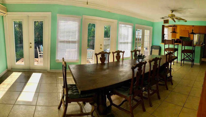 Dining room opens onto kitchen and patio
