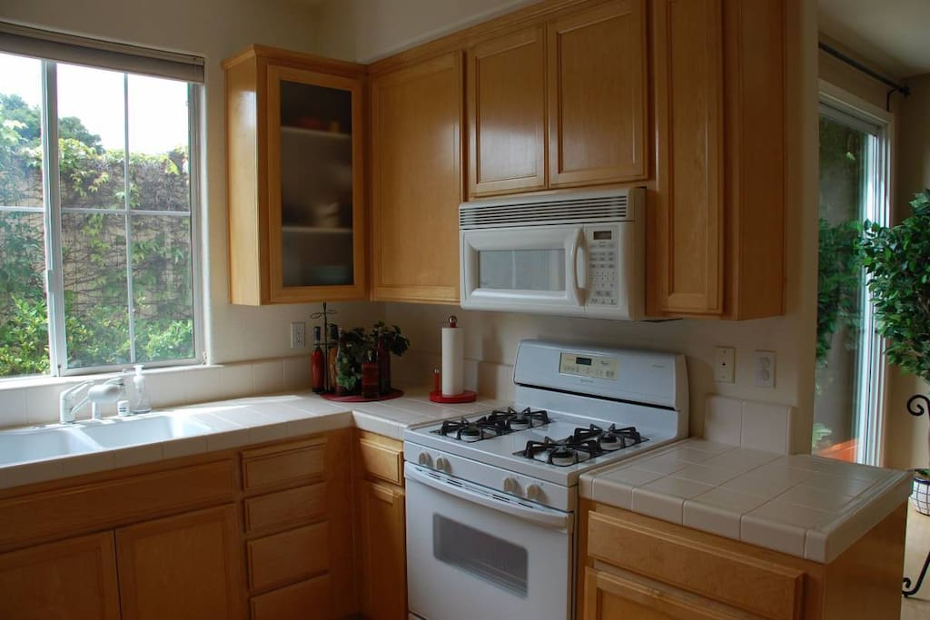 Kitchen with dishwasher, microwave, stove
