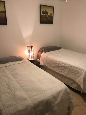 Cozy room ,close to airport next to calle ocho.