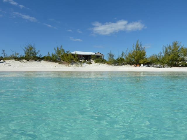 Sundance Beach House - beautiful swimming in turquoise waters right in front of the house.