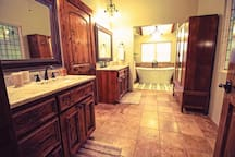 Master bathroom with large soaking tub and walk in shower.