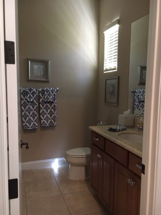 Full bath with walk-in closet