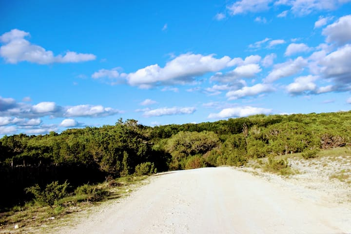 Unpaved caliche road to get to Oeste