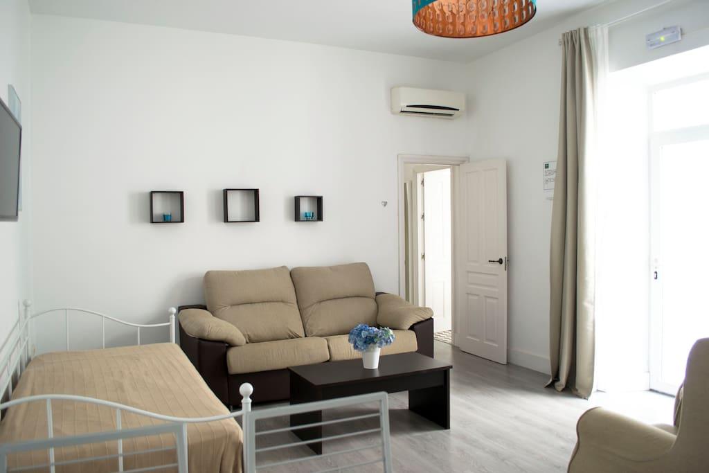 camas individuales en el salón
