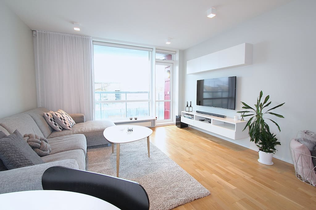 Bright and spacious living room where you can walk out to a balcony facing the town.