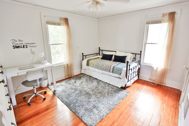 Second bedroom includes twin with pull-out trundle and desk area.