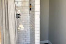 Two stand up showers with rain style shower head