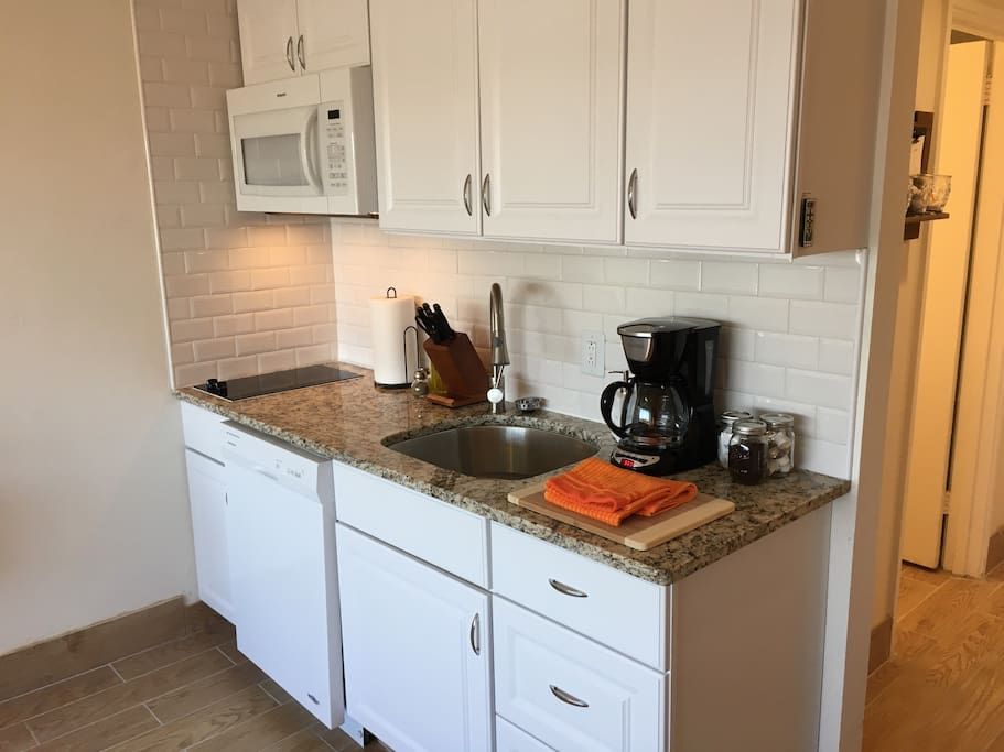 The kitchenette has everything you could need.  Cooktop, microwave, sink with disposal, coffee maker,  refrigerator, freezer and toaster oven are available.