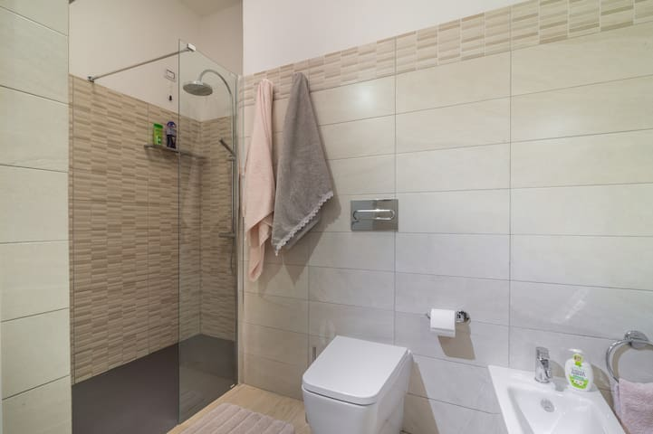 A spacious, modern and elegant and relaxing bathroom, with mosaic shower room and digitally controlled hot water.