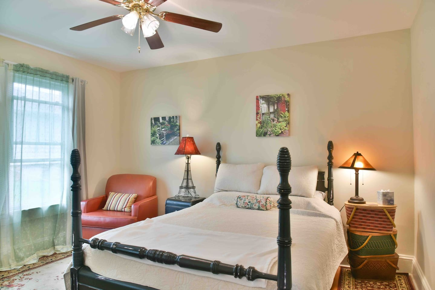 Guests rave about comfortable bed in the Paris room. Ceiling fan and blackout curtains make room extra comfy.