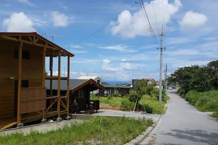 Country log cabin in Nakijin - Haus