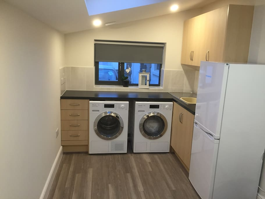 Kitchenette includes laundry facilities (washer and dryer),  induction hob and fridge freezer
