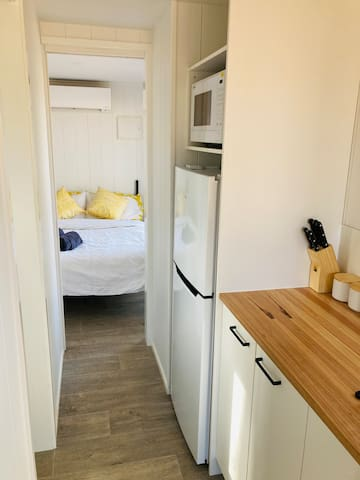 A 3/4 fridge, microwave, electric frypan, cooking utensils, cutlery and crockery provides guests at the Pyrenees Tiny House with all the necessities.