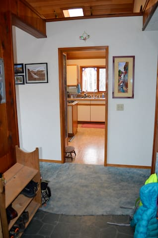 Standing in the entryway looking toward the kitchen.