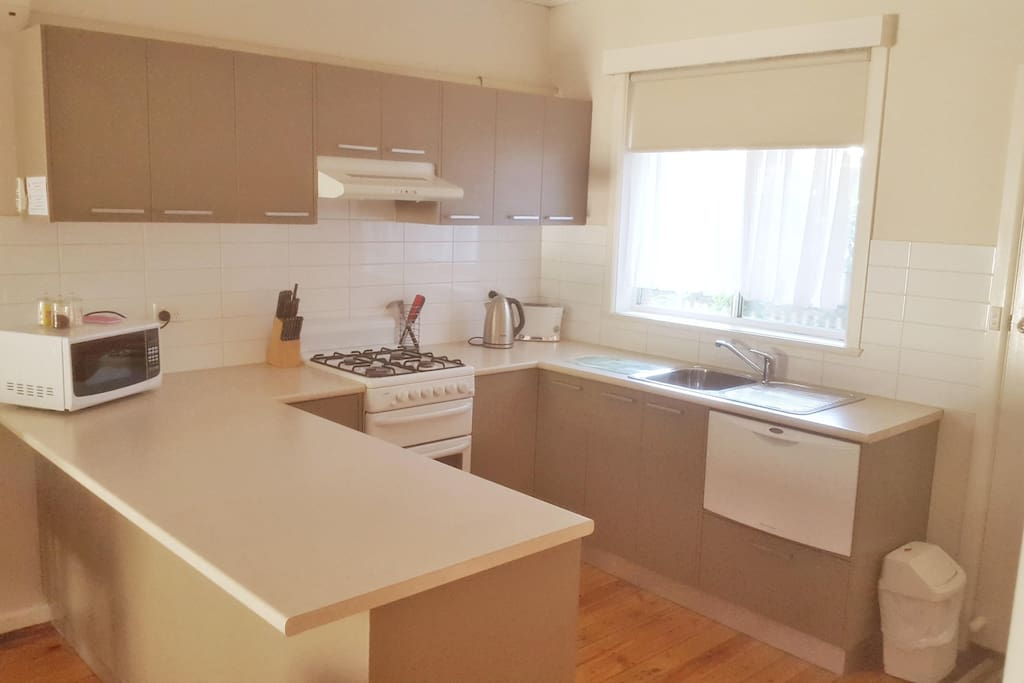 Large kitchen with full cooking facilities and diswasher
