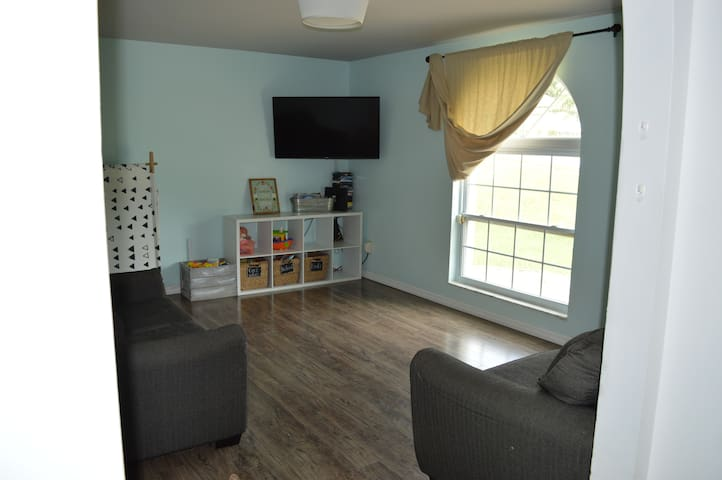 To the right of the entry way is the family room. We have a smart TV (Netflix/Hulu/Prime compatible), a love seat, full sized couch, organized toy area, and lots of blankets for cozy evenings :)