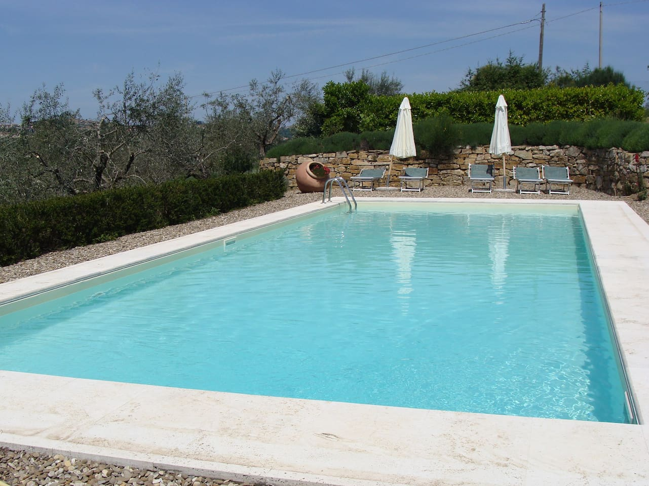 The swimming pool is shared with other guests