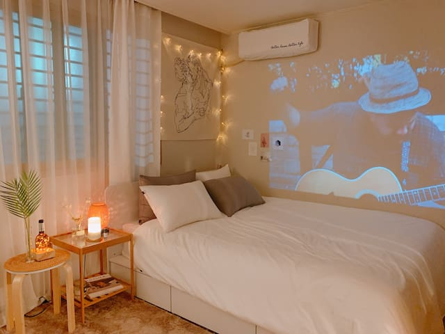 Queen bed and Beam projector