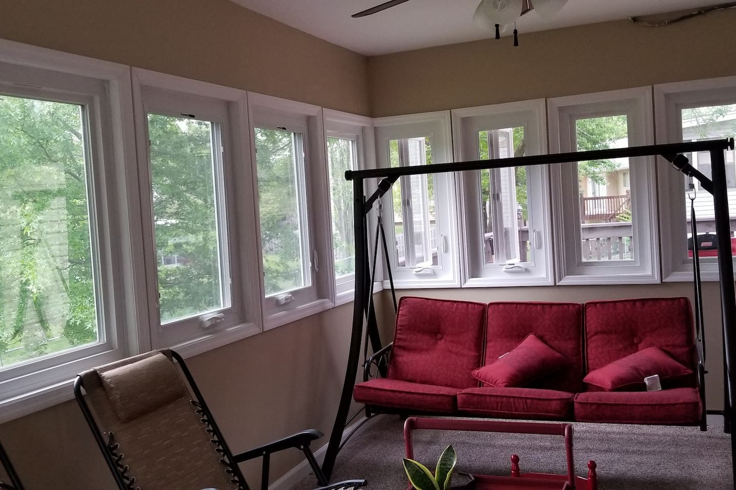 Newly renovated enclosed porch / sunroom. It has swing, HDTV and a view of backyard.