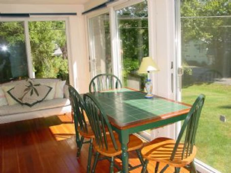 Read a book or enjoy a meal on the indoor/ outdoor porch .....