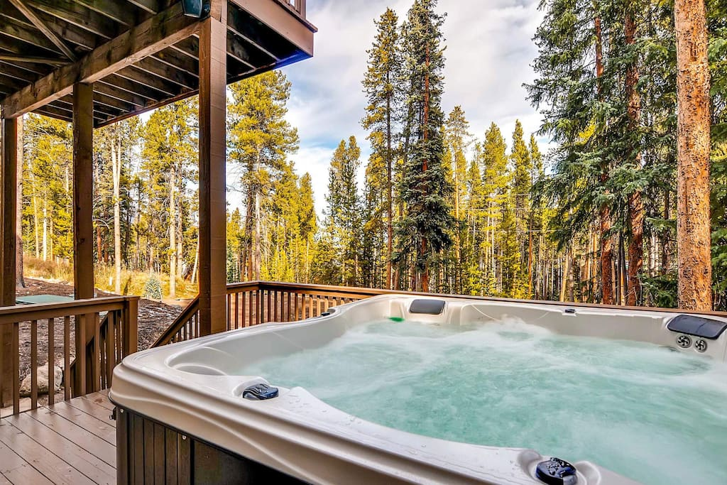 Enjoy a relaxing soak in the private outdoor hot tub - with waterfall.