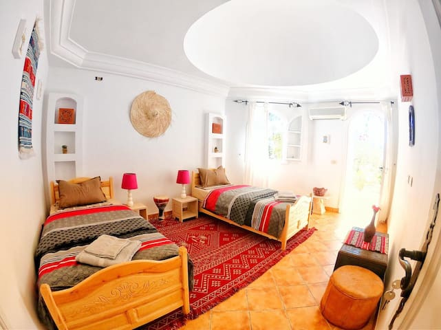 Your cozy room in a typical Villa under palmtrees