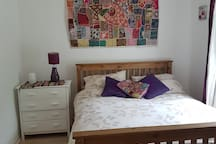 King Size Bed with memory foam mattress, bed sheets and pillows. Chest of drawers for storage and bed side lamp for light all provided.