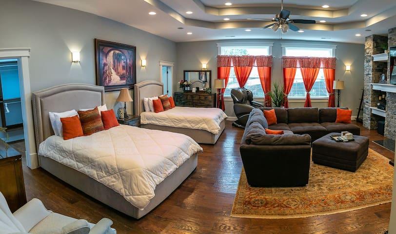 Impressive master suite with wet bar, refrigerator & fireplace; wonderful massage chair