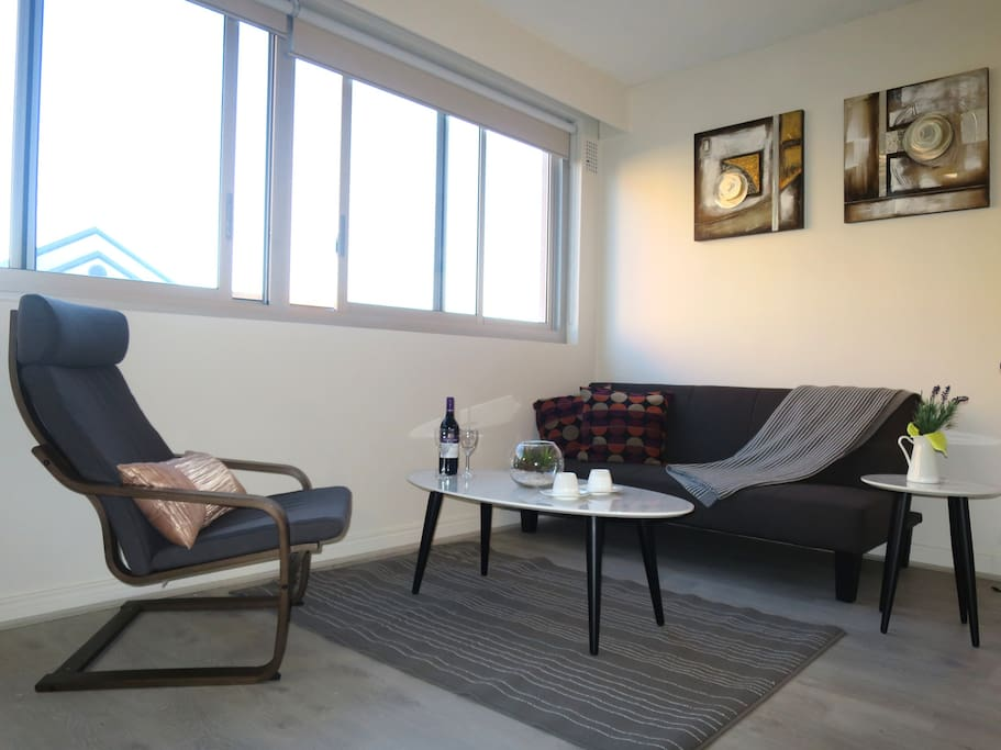 Brand new spacious lounge area - with comfy arm chair and double sofa/futon