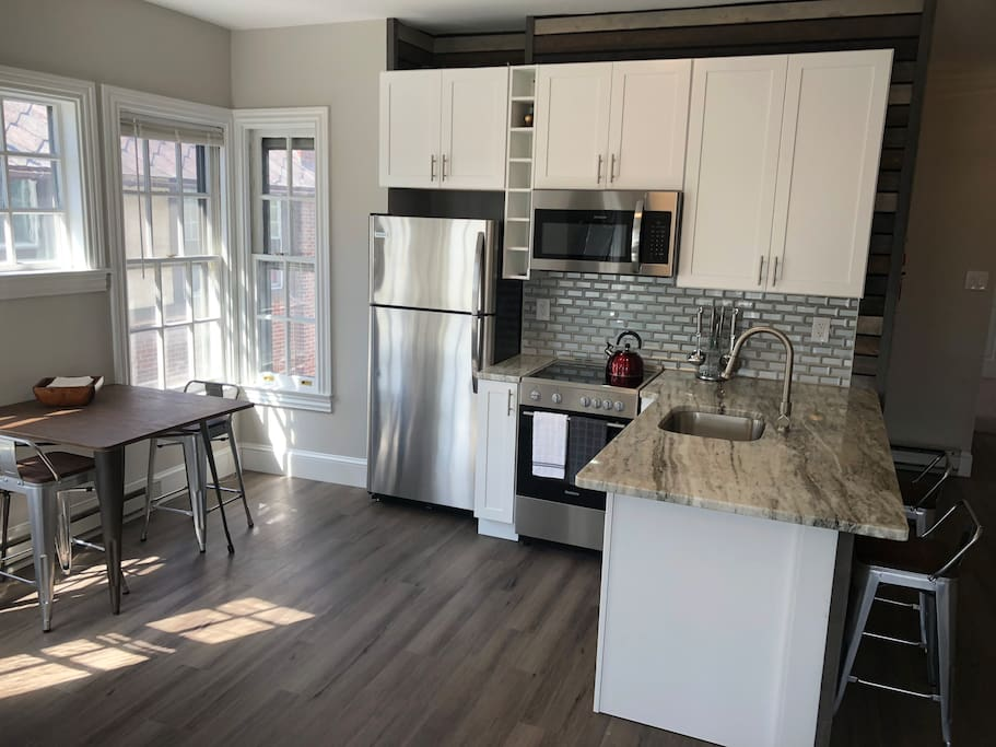 Open Brand New Kitchen w Bar and dining area