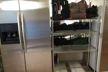 Guest luggage storage and full refrigerator in the mudroom at the entry.