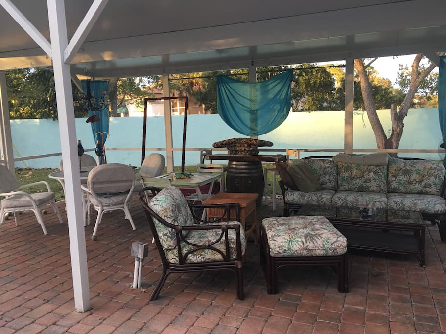 The peacefulness of the covered part of the outside lanai which covers the whole pool area