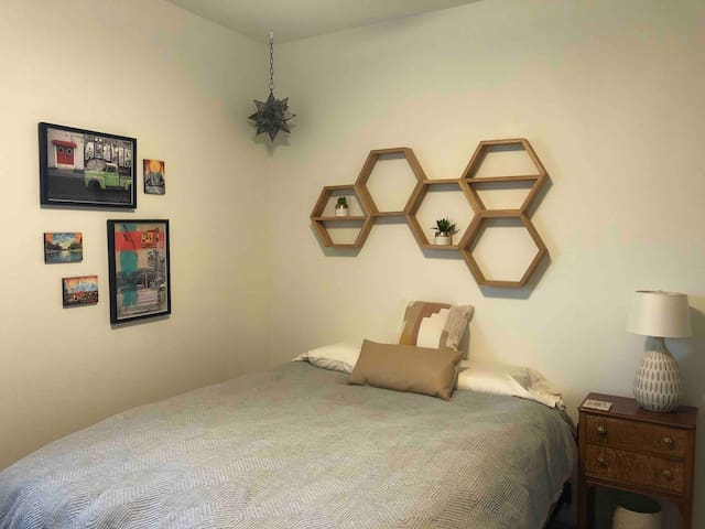 Guest bedroom with queen bed, TV with access to Hulu and Netflix and dresser