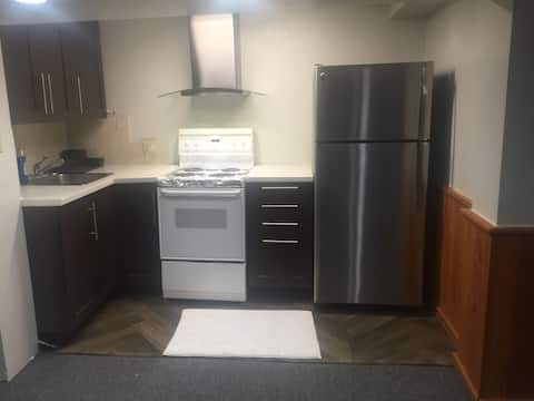 Entire basement with 1 bedroom + 2 parking spot