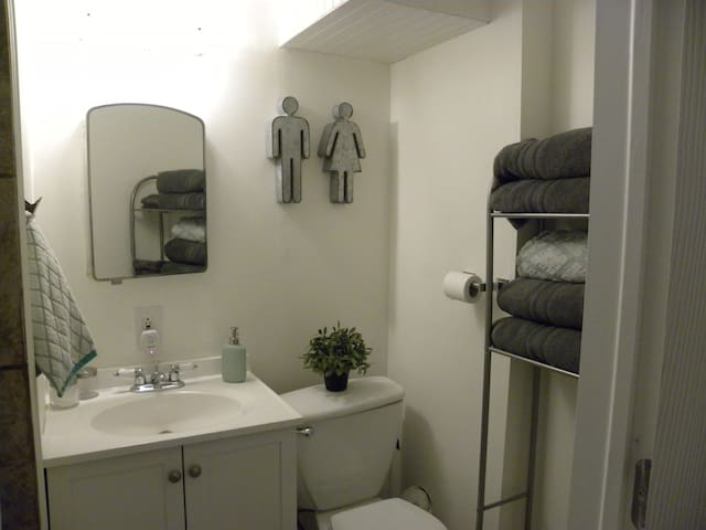 Bathroom with shower and lots of linens, shampoo, conditioner, body wash and anything you may have forgotten.