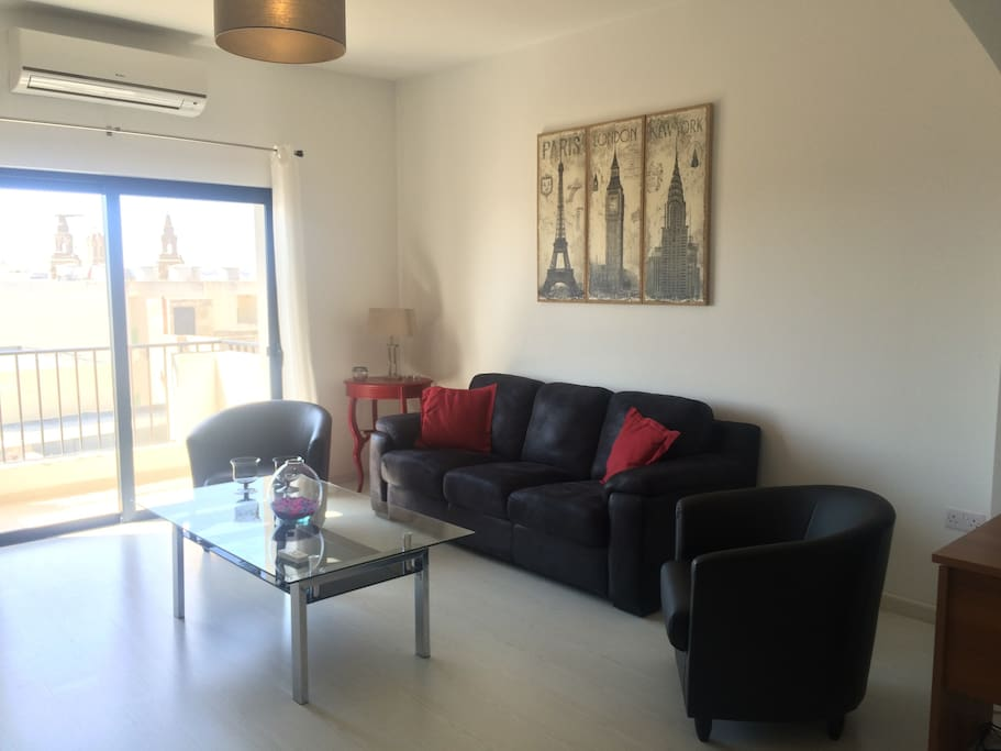 Enjoy relaxing in this spacious and bright living room, fully airconditioned, and equipped with a big TV and a soundbar to hear your own music (Bluetooth). Enjoy distant views of the capital city Valletta and spot the numerous church steeples.