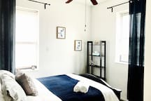 Bedroom with closet and basic travel amenities such as iron, ironing board, hangers